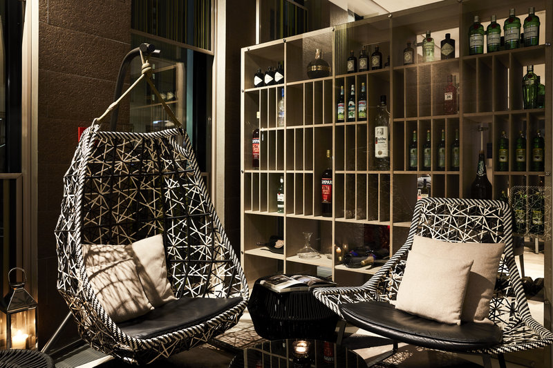 Hotel Indigo Berlin Centre Alexanderplatz-Cushioned seats and a hanging pod chair in the stylish lobby.<br/>Image from Leonardo