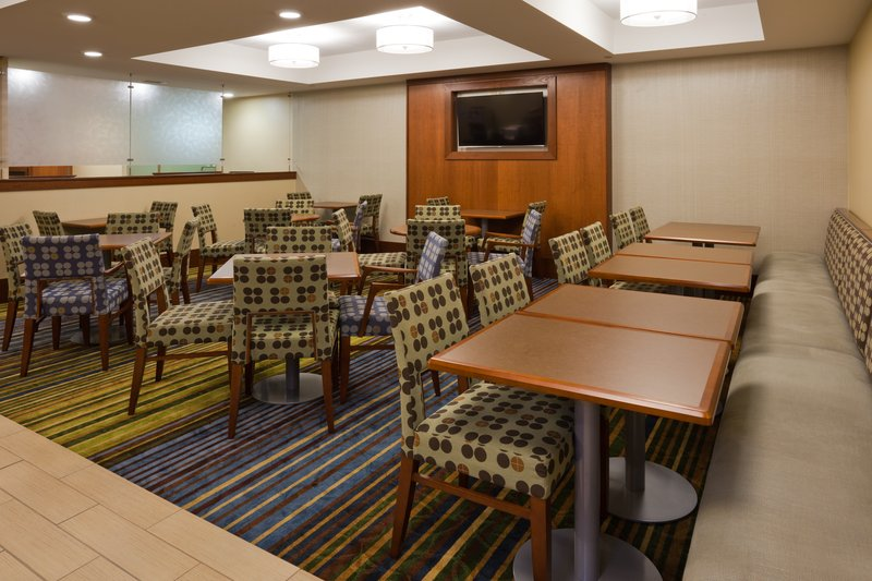 Holiday Inn Express Cedar Rapids (Collins Rd)-Relax in our breakfast area  morning, noon, and night.<br/>Image from Leonardo