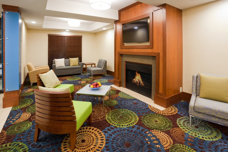 Holiday Inn Express Cedar Rapids (Collins Rd)-Hotel Lobby with comfortable seating and fireplace<br/>Image from Leonardo