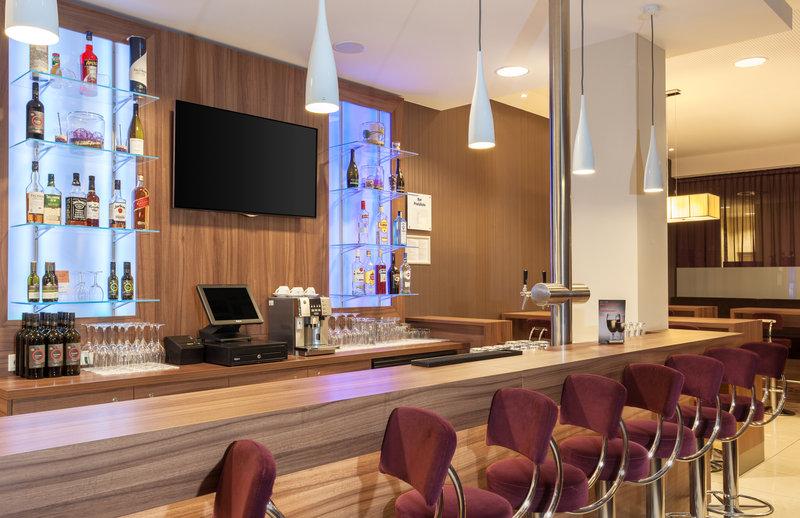 Holiday Inn Express Nuremberg City - Hauptbahnhof-The 24-hour bar awaits for well-earned drinks after work.<br/>Image from Leonardo