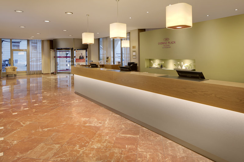 Crowne Plaza Hannover-A welcoming Crowne Plaza hotel lobby and front desk.<br/>Image from Leonardo