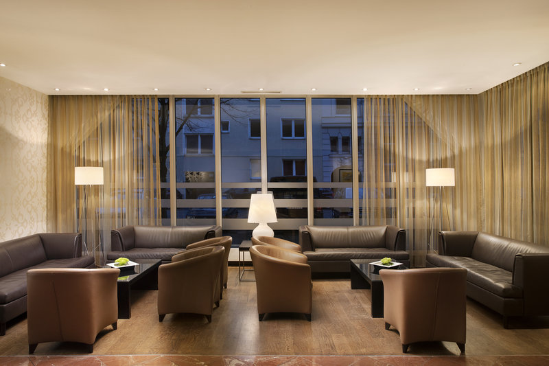 Crowne Plaza Hannover-Leather couches and armchairs to sink into in the lobby.<br/>Image from Leonardo