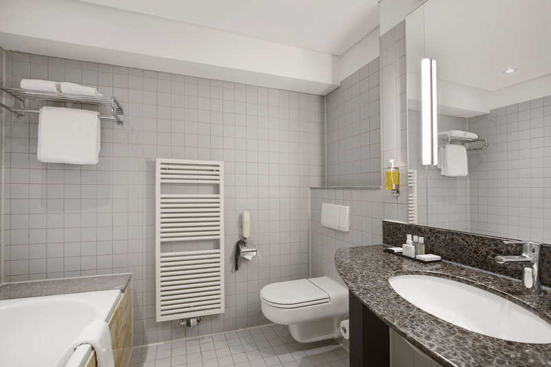 Crowne Plaza Hannover-A large bathroom with a soaking tub and a towel warmer. <br/>Image from Leonardo