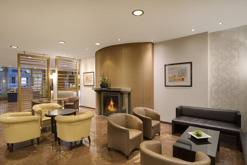 Crowne Plaza Hannover-The lobby fireplace is lit on particularly cold winter days.<br/>Image from Leonardo
