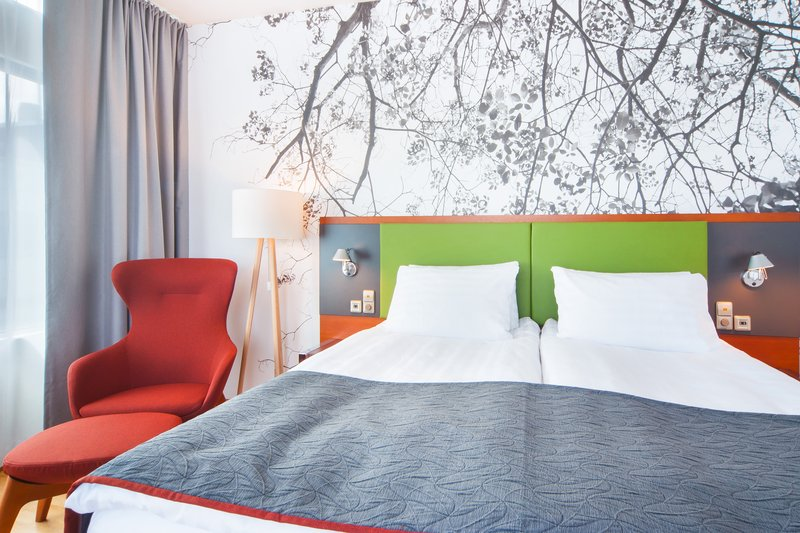 Holiday Inn Helsinki City Centre-Sleep well in our comfortable Executive room King bed<br/>Image from Leonardo