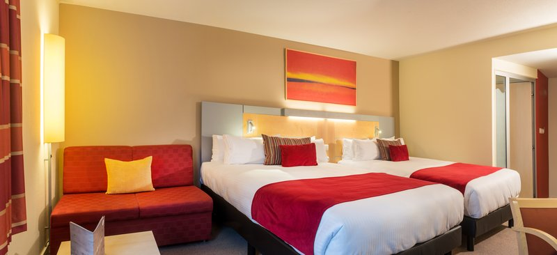 Holiday Inn Express Gent-Queen Room with 2 Queen Beds and Sofa<br/>Image from Leonardo