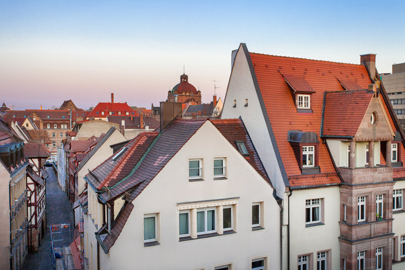 Holiday Inn Nuernberg City Centre-Views of red-tiled roofs in central Nürnberg from a superior room.<br/>Image from Leonardo