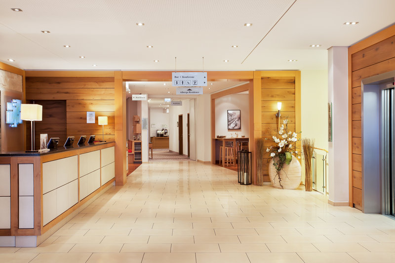 Holiday Inn Nuernberg City Centre-Spacious lobby and front desk at the hotel, with inclusive Wi-Fi.<br/>Image from Leonardo