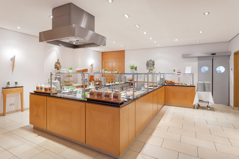 Holiday Inn Nuernberg City Centre-Plenty of hot and cold choices at a Holiday Inn breakfast buffet.<br/>Image from Leonardo