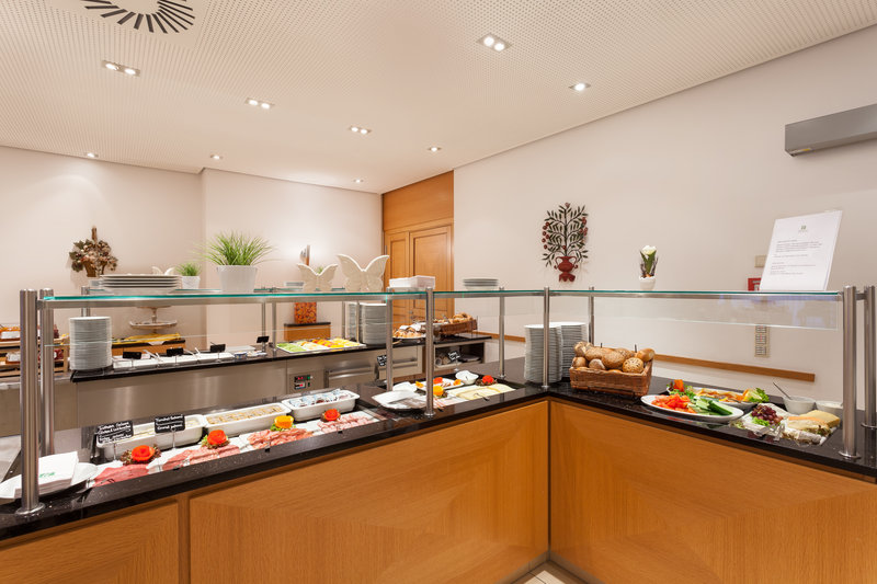 Holiday Inn Nuernberg City Centre-A tempting breakfast buffet, including cured German meats.<br/>Image from Leonardo