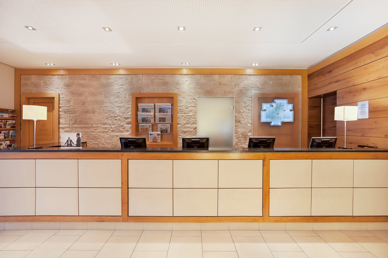 Holiday Inn Nuernberg City Centre-The front desk welcomes guests to the Holiday Inn in Nürnberg.<br/>Image from Leonardo