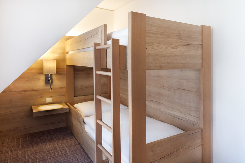 Holiday Inn Nuernberg City Centre-Bunk beds in a comfortable family room, where kids sleep free.<br/>Image from Leonardo
