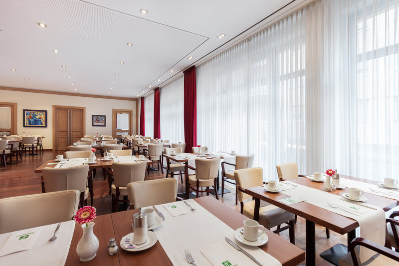 Holiday Inn Nuernberg City Centre-Well-lit St. Jakob restaurant for breakfast, with inclusive Wi-Fi.<br/>Image from Leonardo