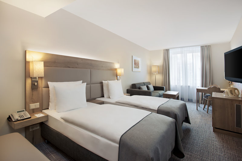 Holiday Inn Nuernberg City Centre-Tastefully designed twin room, with a sofa and large windows.<br/>Image from Leonardo