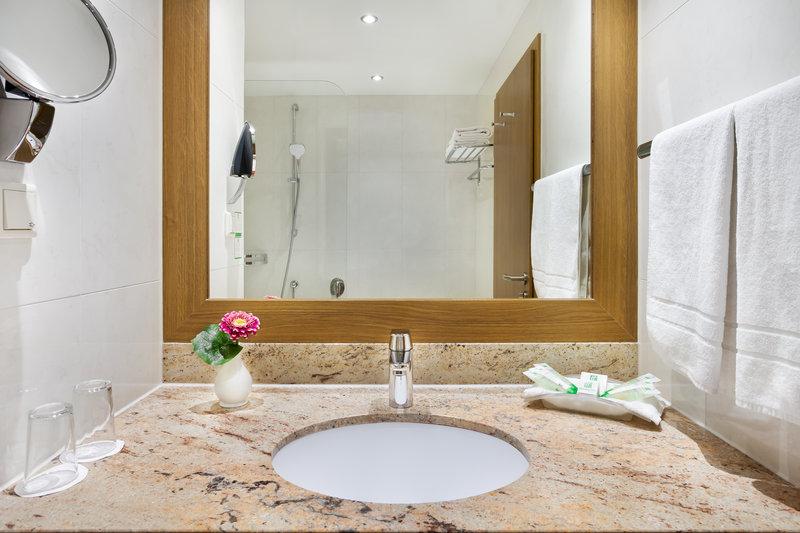Holiday Inn Nuernberg City Centre-A large mirror in a bathroom at Holiday Inn Nürnberg City Centre.<br/>Image from Leonardo