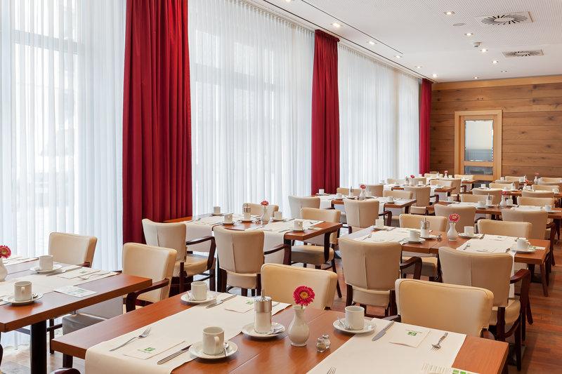 Holiday Inn Nuernberg City Centre-Breakfast at St. Jakob restaurant, with floor-to-ceiling windows.<br/>Image from Leonardo