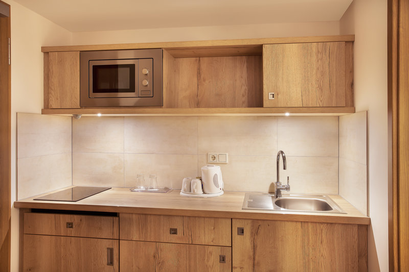 Holiday Inn Nuernberg City Centre-A well-equipped kitchen in a suite, with a microwave and kettle.<br/>Image from Leonardo