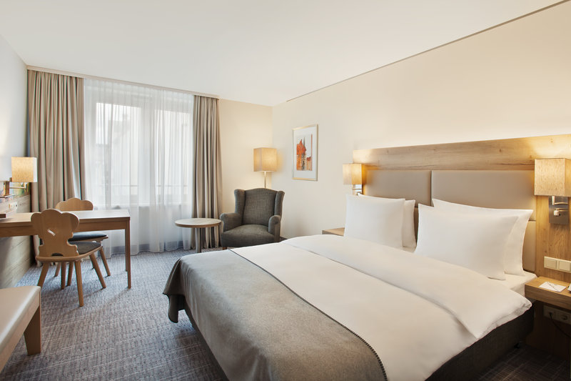 Holiday Inn Nuernberg City Centre-A comfortable queen-size room with a pillow menu. <br/>Image from Leonardo