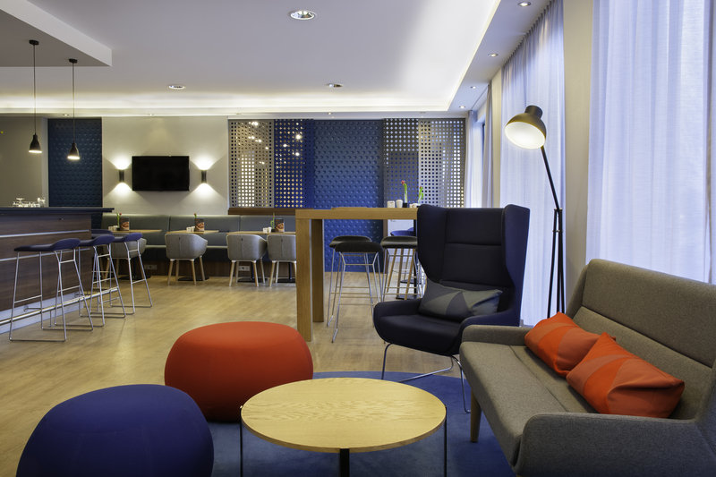 Holiday Inn Express Stuttgart Airport-Colourful designer seating in the contemporary open plan lobby.<br/>Image from Leonardo