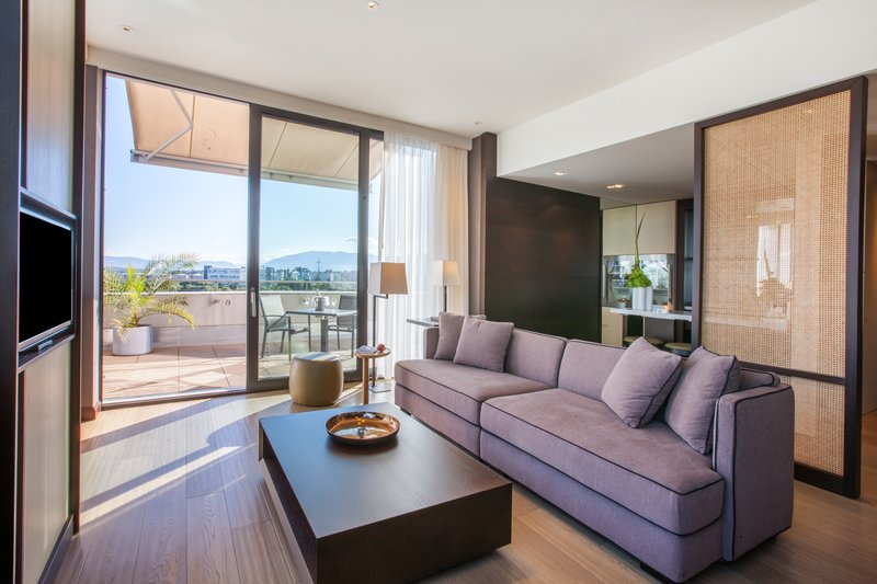 Crowne Plaza Geneva-King Club Suite living room with private terrace<br/>Image from Leonardo