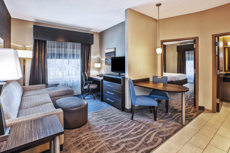 Holiday Inn Express & Suites Dayton South - I-675-Spacious living and dining areas when booking an executive suite. <br/>Image from Leonardo