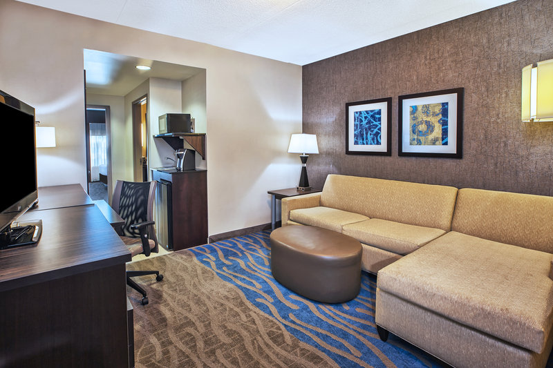 Holiday Inn Express & Suites Dayton South - I-675-Junior suite living space with a spacious pull out sofa.<br/>Image from Leonardo