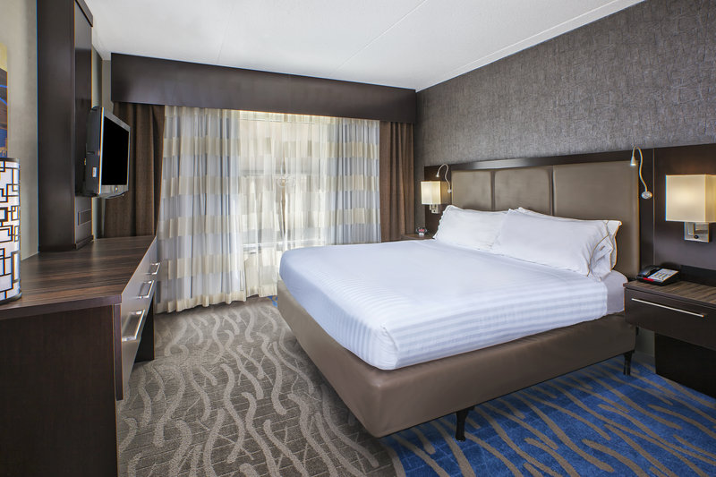 Holiday Inn Express & Suites Dayton South - I-675-Comfortable King bed after a long days work. <br/>Image from Leonardo
