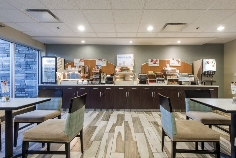 Holiday Inn Express & Suites Colorado Springs Central-Read the newspaper while you enjoy fresh, hot coffee at breakfast.<br/>Image from Leonardo