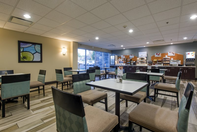 Holiday Inn Express & Suites Colorado Springs Central-Hot, complimentary breakfast feat. our signature cinnamon rolls<br/>Image from Leonardo
