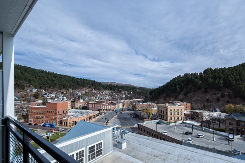 Holiday Inn Resort Deadwood Mountain Grand-View from room with an outdoor patio overlooking downtown Deadwood<br/>Image from Leonardo