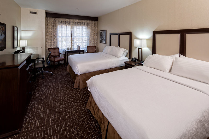 Holiday Inn Resort Deadwood Mountain Grand-Our standard double queen offers plenty of space to stretch out.<br/>Image from Leonardo