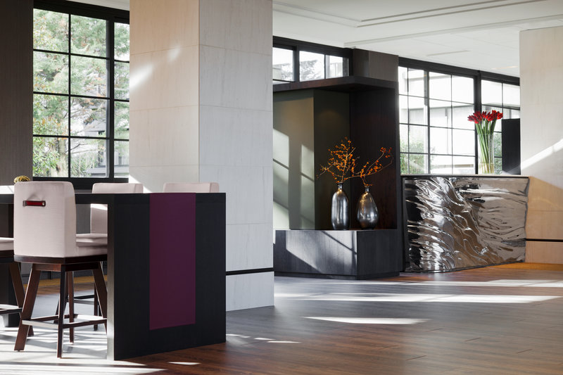 Crowne Plaza Geneva-Reception with comfortable business and relaxing sitting areas<br/>Image from Leonardo