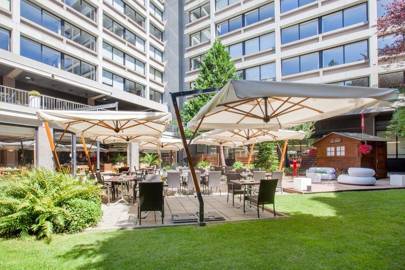 Crowne Plaza Geneva-Café Jardin garden with Swiss Chalet<br/>Image from Leonardo