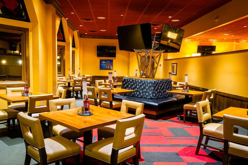 Holiday Inn Big Rapids-Restaurant lower seating with television tower<br/>Image from Leonardo