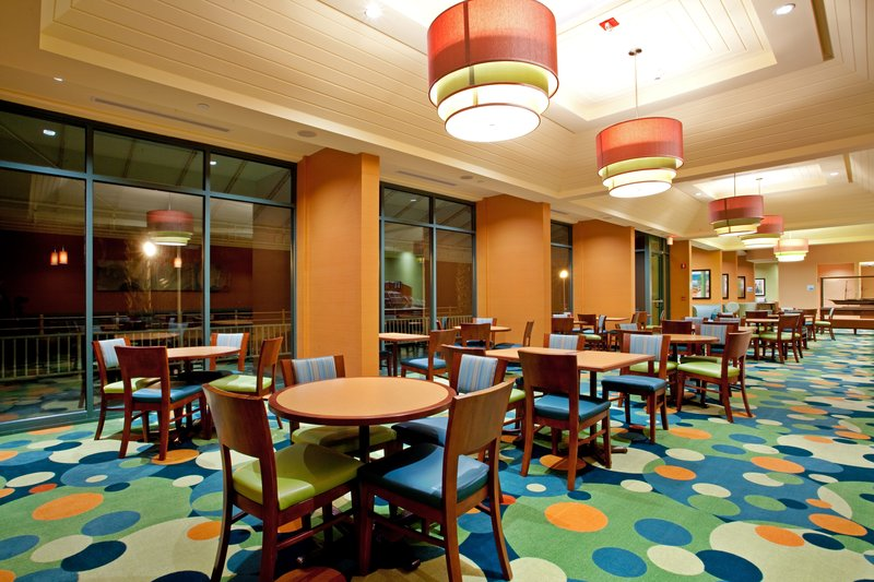 Holiday Inn Express And Suites Virginia Beach Oceanfront-Room opens onto patio for seasonal outdoor dining<br/>Image from Leonardo