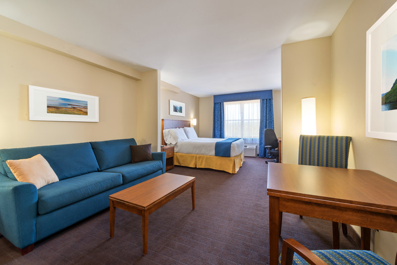 Holiday Inn Express Deer Lake-1 Queen Bed with Sofa Bed and Bunk Bed Guestroom Living Space<br/>Image from Leonardo