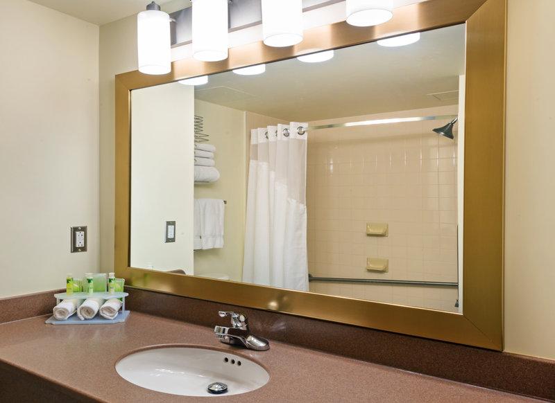 Holiday Inn Express Deer Lake-Guest Bathroom with Bath & Body Works Amenities<br/>Image from Leonardo