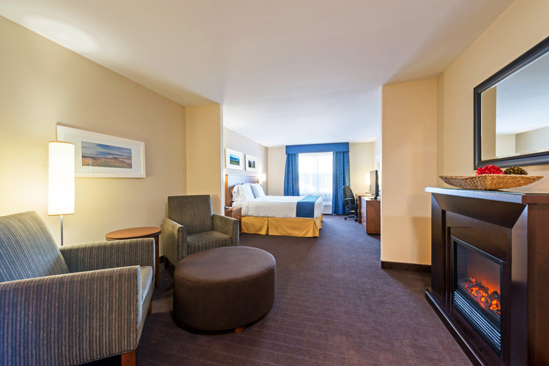 Holiday Inn Express Deer Lake-Relax in Front of our Cozy Fireplace<br/>Image from Leonardo