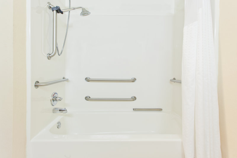 Holiday Inn Express & Suites Douglas-ADA/Handicapped accessible Guest Bathroom with mobility tub<br/>Image from Leonardo