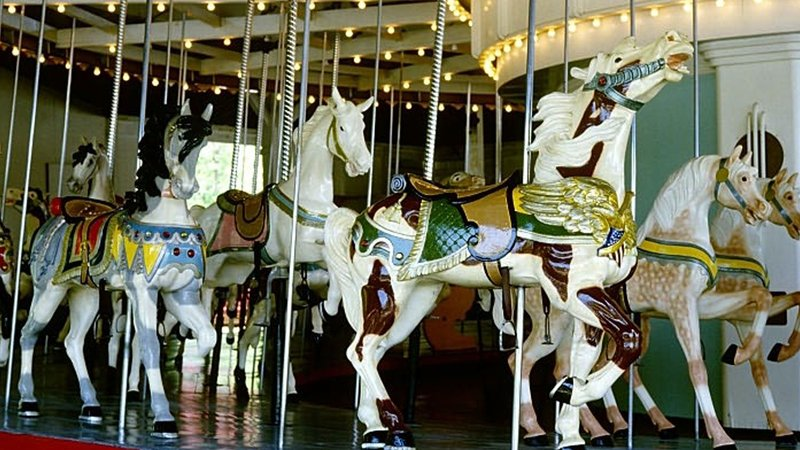 Holiday Inn Elmira - Riverview-The Carousel, with a brass ring feeder, at Eldridge Park, Elmira<br/>Image from Leonardo