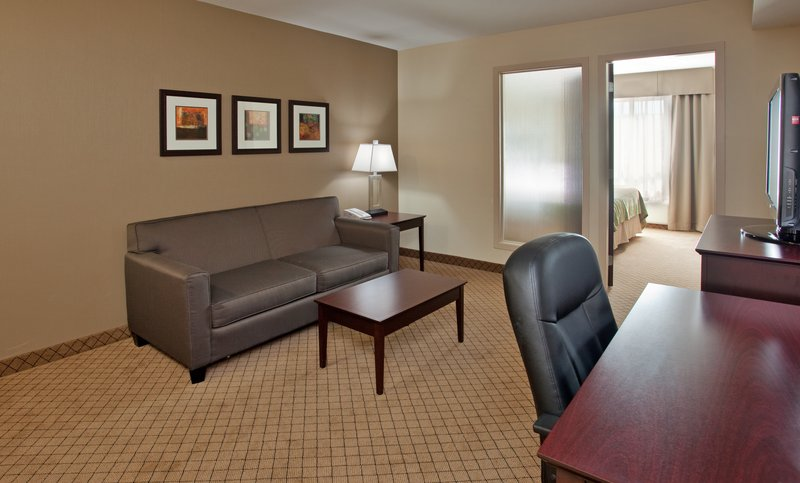 Holiday Inn Hotel & Suites Kamloops-Suite Living Room with Sofa Bed, Mini Fridge & Microwave<br/>Image from Leonardo