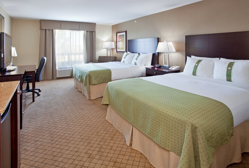 Holiday Inn Hotel & Suites Kamloops-Two Queen Bed Guest Room with Mini Fridge and Corner Chair<br/>Image from Leonardo