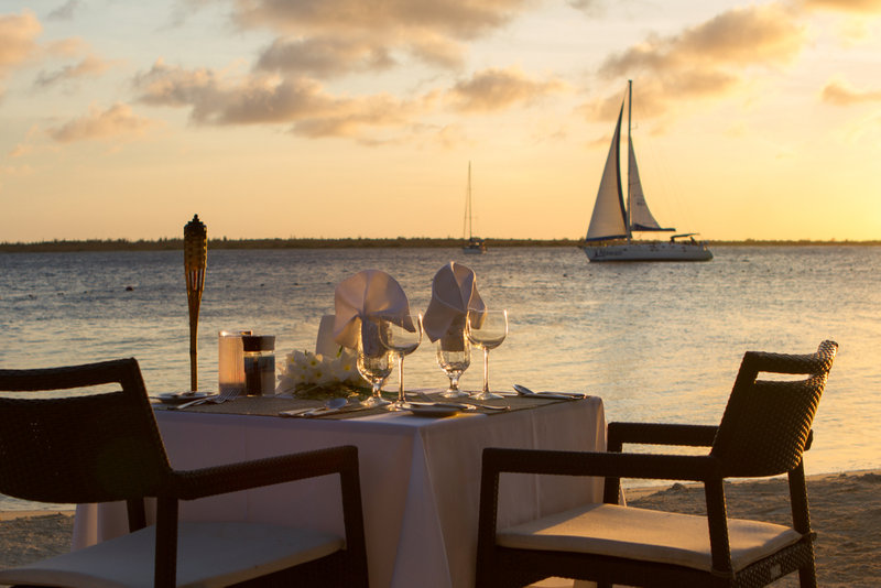 Harbour Village Beach Club-Torch lit dining on the beach<br/>Image from Leonardo