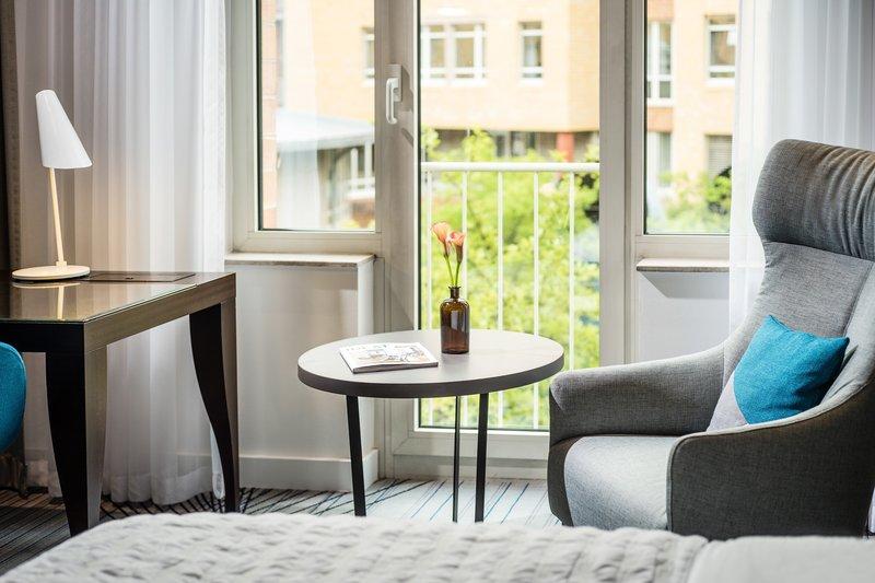Le Meridien Stuttgart-Deluxe Chic Room Seating Area<br/>Image from Leonardo