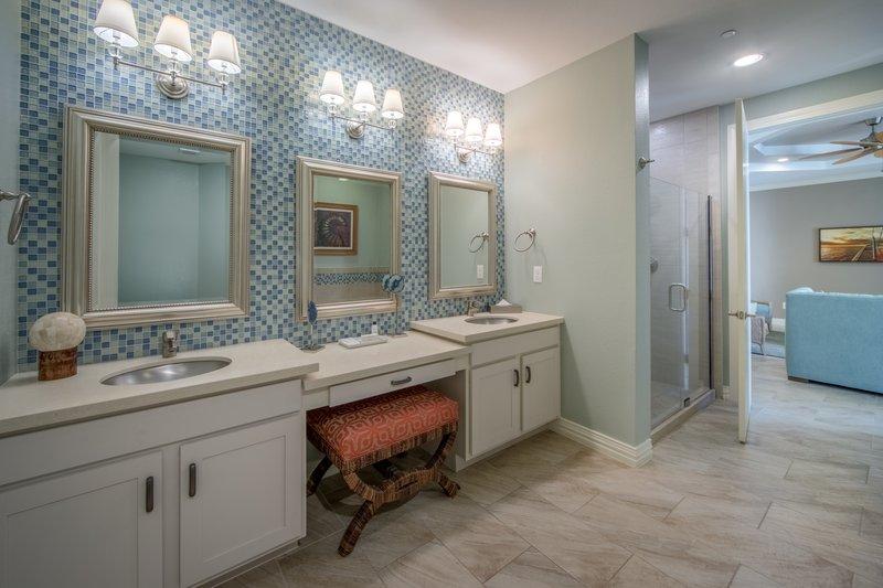 Holiday Inn Club Vacations Galveston Beach Resort-Dual sinks in a luxurious Signature Collection bathroom<br/>Image from Leonardo