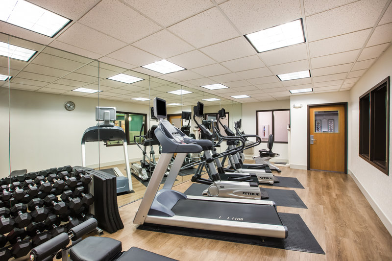 Holiday Inn Express & Suites Bellevue (Omaha Area)-Our Fitness Center includes cardio equipment and free weights.<br/>Image from Leonardo