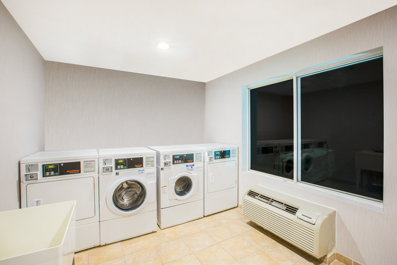 Holiday Inn Express & Suites Bellevue (Omaha Area)-Use our convenient coin-operated laundry facilities.<br/>Image from Leonardo
