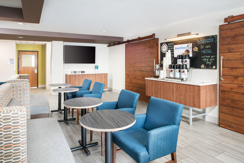 Holiday Inn Express & Suites Bellevue (Omaha Area)-Start your day by relaxing in our spacious breakfast area!<br/>Image from Leonardo
