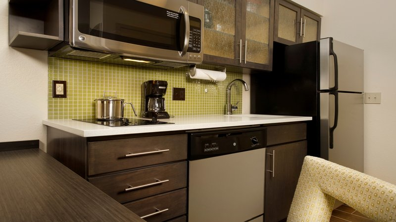Candlewood Suites Alexandria - Fort Belvoir-Full kitchen with fridge, stovetop, microwave, cookware & utensils<br/>Image from Leonardo