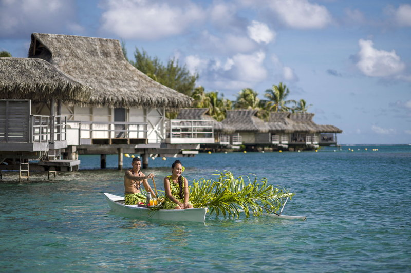 Intercontinental Moorea Resort-Canoe breakfast delivered by traditional outrigger canoe.<br/>Image from Leonardo